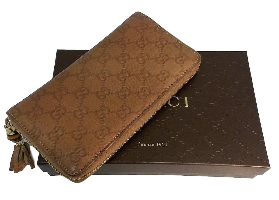 32b20a665aae Gucci Brown Leather Monogram Bifold Zip Around Wallet - Tradesy