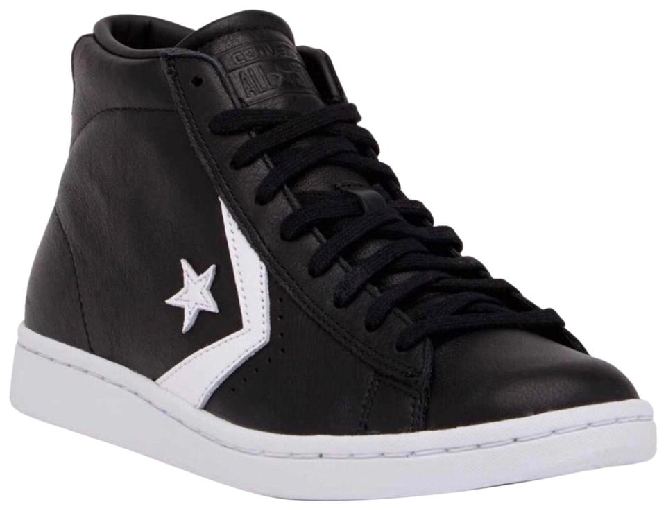 588f88ca23f4 Converse Leather Mid High Tops Chuck Taylor Sneakers Sneakers Size ...