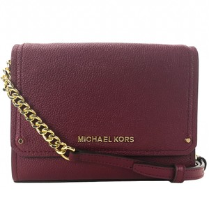 31f39a292abc Added to Shopping Bag. Michael Kors Cross Body Bag. Michael Kors Clutch  Hayes Small Convertible Red Leather ...