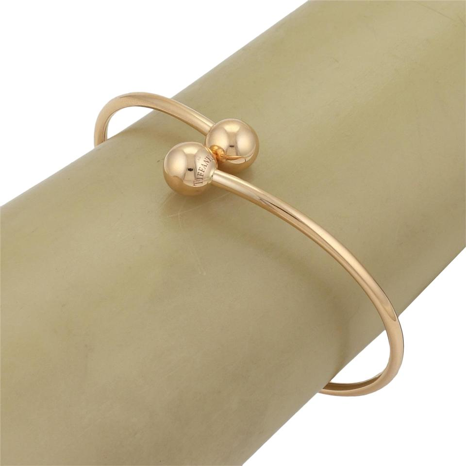e7f3f2e84 Tiffany & Co. Hard Wear Wire Bypass Ball 18k Gold Bangle Bracelet Image 0  ...