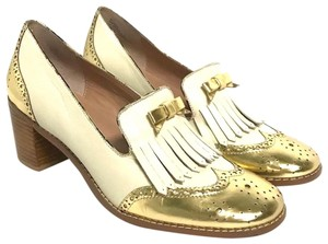 503b70d7a03 Miss Albright Anthropologie Leather   Kiltie Gold ivory Pumps