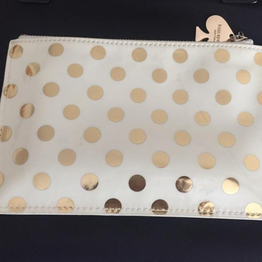 Kate Spade Wristlet in Gold Polka Dots Image 1