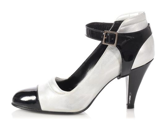 Preload https://img-static.tradesy.com/item/23880534/chanel-silver-leather-and-black-patent-cap-toe-ankle-strap-stirrup-pumps-size-eu-385-approx-us-85-re-0-0-540-540.jpg