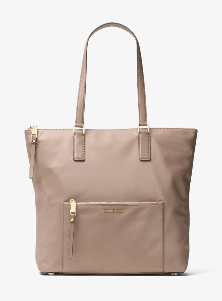 28a054decb24 Michael Kors Light Weight Gray Nylon Tote in DUSK GOLD Image 11.  123456789101112