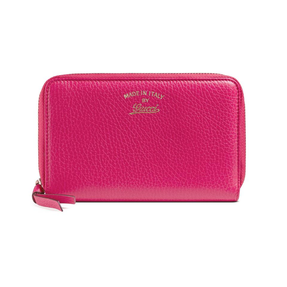 63a0155827d Gucci Gucci Women s Fuchsia Leather Swing Zip Around Wallet Image 0 ...