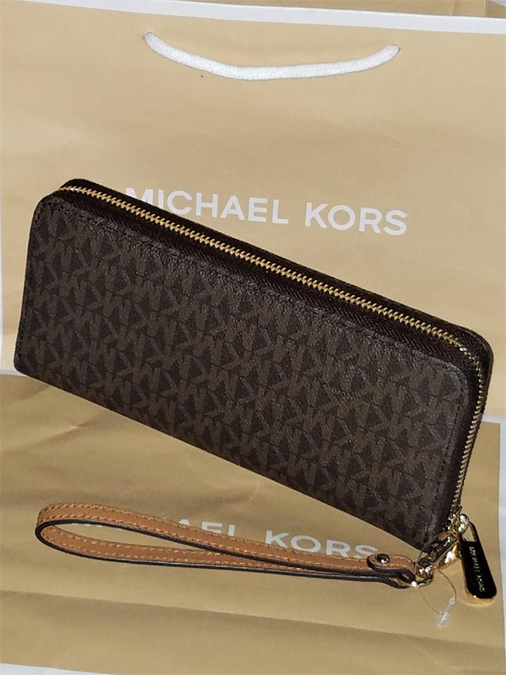 1a2eee1f0c6a Michael Kors Brown Mk Jet Set Travel Continental Large Wristlet Wallet -  Tradesy