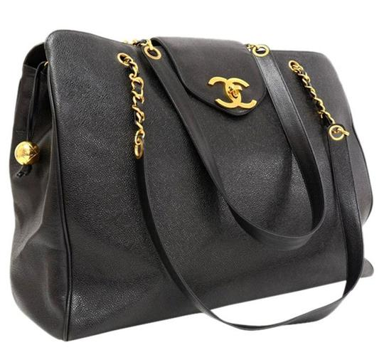 Preload https://item3.tradesy.com/images/chanel-classic-flap-vintage-rare-overnight-luggage-tote-black-caviar-leather-weekendtravel-bag-23887742-0-1.jpg?width=440&height=440
