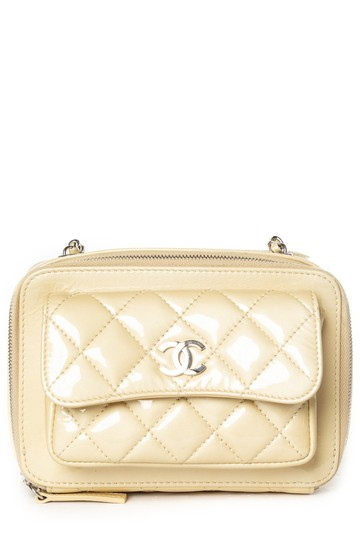 Preload https://img-static.tradesy.com/item/23887750/chanel-camera-small-pocket-box-case-cream-patent-leather-cross-body-bag-0-0-540-540.jpg
