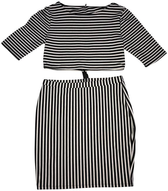 Preload https://item1.tradesy.com/images/forever-21-black-and-white-cut-out-short-casual-dress-size-12-l-23887830-0-1.jpg?width=400&height=650