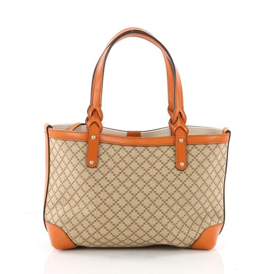 Preload https://item4.tradesy.com/images/gucci-craft-diamante-small-brown-canvas-tote-23887923-0-0.jpg?width=440&height=440