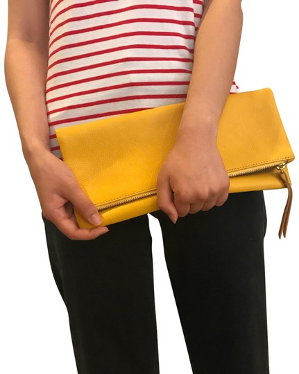 Preload https://item3.tradesy.com/images/banana-republic-foldover-yellow-leather-clutch-23888262-0-1.jpg?width=440&height=440