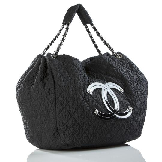 Preload https://item1.tradesy.com/images/chanel-coco-cabas-cabas-overnight-tote-black-microfiber-nylon-and-patent-leather-weekendtravel-bag-23888400-0-0.jpg?width=440&height=440