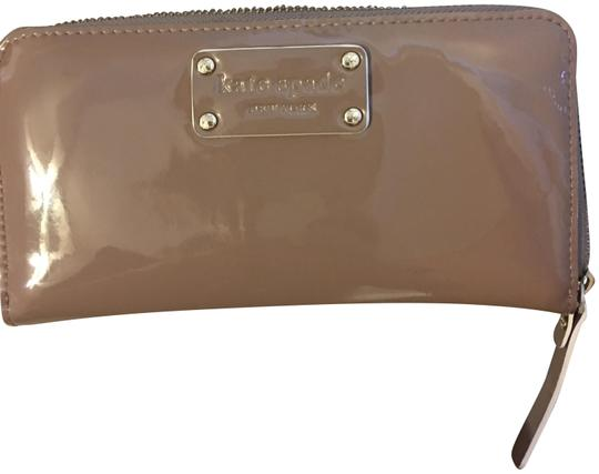 Preload https://item5.tradesy.com/images/kate-spade-beige-classic-patent-leather-full-size-wallet-23888429-0-1.jpg?width=440&height=440