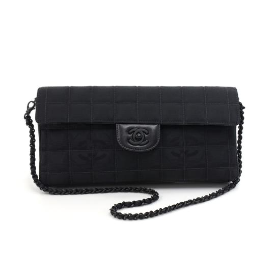 Preload https://item2.tradesy.com/images/chanel-classic-flap-new-travel-line-quilted-black-nylon-shoulder-bag-23888436-0-0.jpg?width=440&height=440