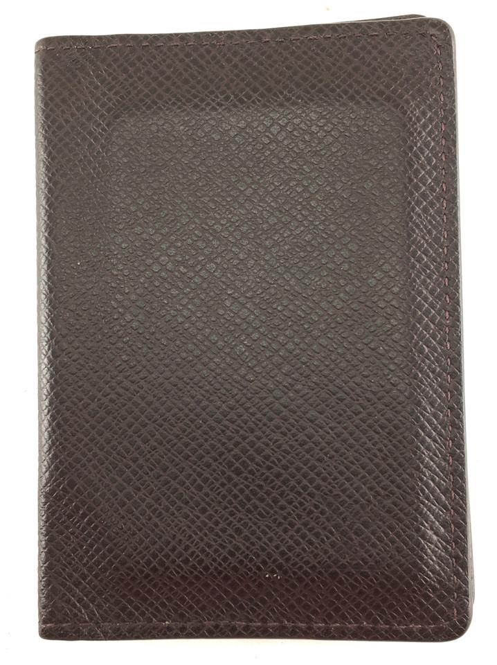 ddb834dba9d7 Louis Vuitton Taiga leather bifold Wallet card holder pocket organizer  Monogram LV Image 0 ...