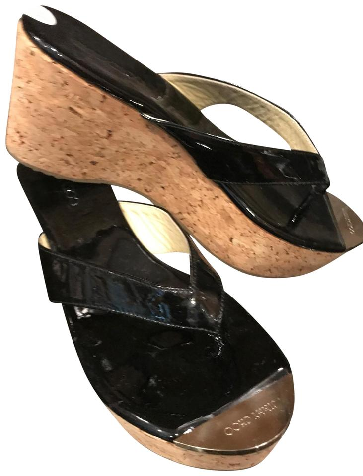 87a96b0d9b7e Jimmy Choo Black Italian Patent Leather With Gold Jimmy Logo Toe Plate  Wedges ...