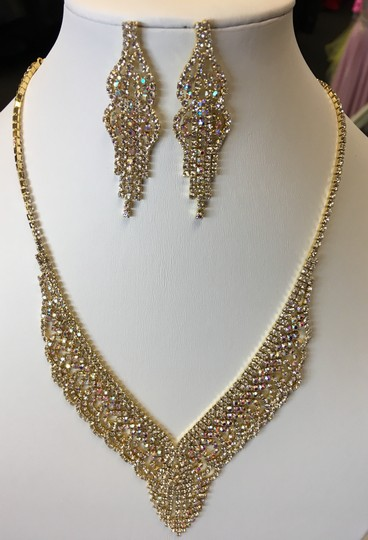 Preload https://img-static.tradesy.com/item/23900148/ab-and-gold-crystal-rhinestone-paved-necklace-jewelry-set-0-0-540-540.jpg