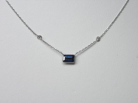 Mishelka & Co. Mishelka Sapphire emerald cut wrapped in platinum with (2) F/G VS Clar