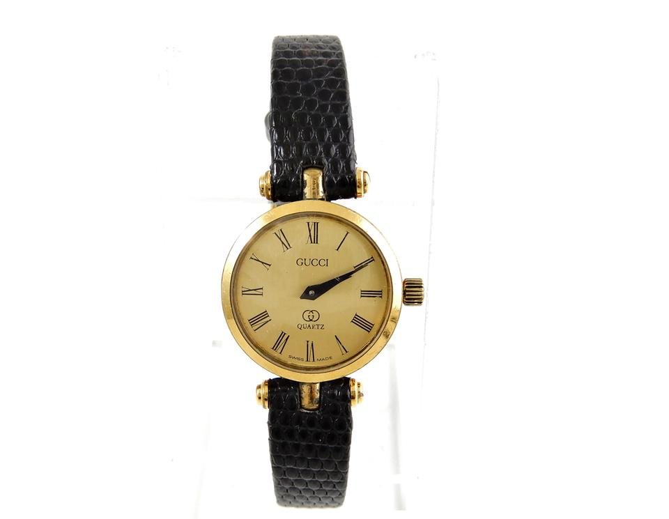 806a25d81be Gucci Gold Plated Stainless Steel Vintage 21mm Web Ribbon Gold Face Watch  Image 0 ...