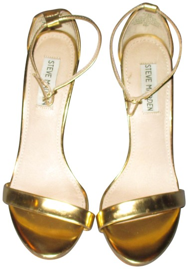 Preload https://img-static.tradesy.com/item/23901652/steve-madden-gold-stecy-pumps-size-us-75-regular-m-b-0-1-540-540.jpg