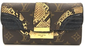 Louis Vuitton Monogram with black alligator skin leather and multicolor ombre python skin leather and oxidized gold tone hardware Clutch