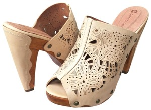 Corso Como Nude with intricate laser cut floral design Mules