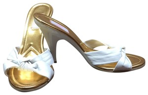 JLo White with gold insole Platforms