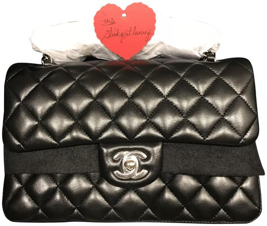 Preload https://item4.tradesy.com/images/chanel-classic-flap-rare-timeless-small-with-silver-hardware-black-lambskin-leather-shoulder-bag-23917108-0-1.jpg?width=440&height=440
