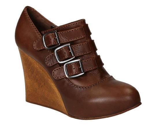Preload https://img-static.tradesy.com/item/23917122/chloe-women-s-wedges-in-brown-leather-pumps-size-us-6-regular-m-b-0-0-540-540.jpg