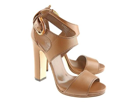Preload https://item4.tradesy.com/images/gucci-high-heel-sandals-in-brown-leather-pumps-size-us-85-regular-m-b-23917213-0-0.jpg?width=440&height=440