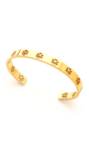 Preload https://img-static.tradesy.com/item/23917225/tory-burch-gold-tone-t-t-pierced-logo-cuff-in-metallic-bracelet-0-0-540-540.jpg