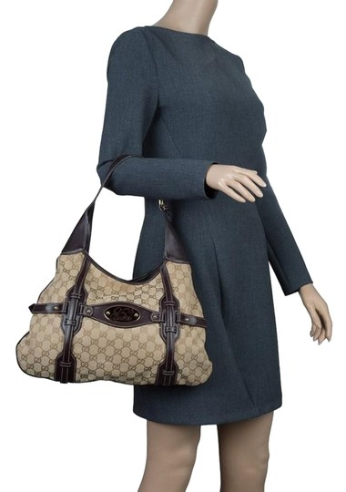 Preload https://item5.tradesy.com/images/gucci-ebony-gg-85th-anniversary-bridle-beige-canvas-and-leather-hobo-bag-23917234-0-1.jpg?width=440&height=440