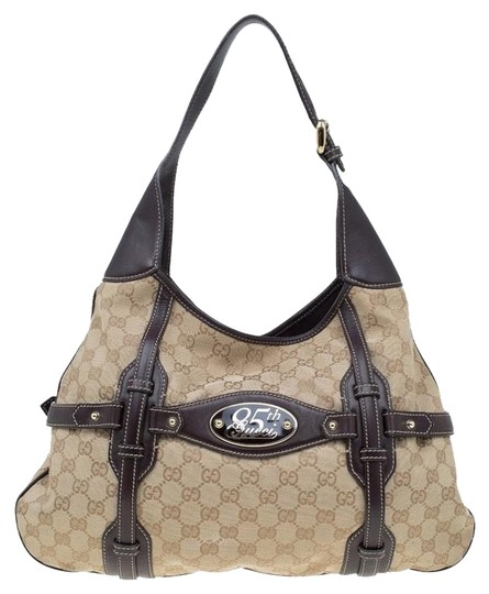 Preload https://img-static.tradesy.com/item/23917234/gucci-ebony-gg-85th-anniversary-bridle-beige-canvas-and-leather-hobo-bag-0-3-540-540.jpg