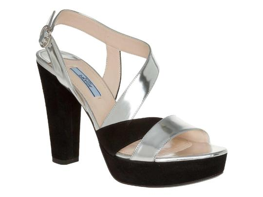 Preload https://item3.tradesy.com/images/prada-sandals-in-silver-metallic-and-black-suede-leather-pumps-size-us-75-regular-m-b-23917282-0-0.jpg?width=440&height=440