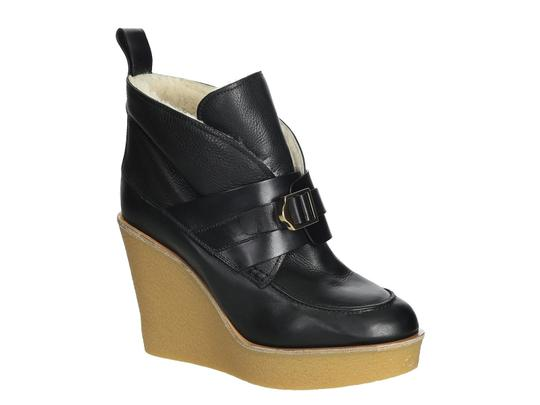 Preload https://item5.tradesy.com/images/chloe-wedges-booties-in-black-leather-fur-lined-pumps-size-us-105-regular-m-b-23917314-0-0.jpg?width=440&height=440