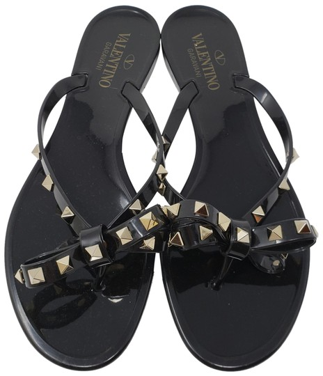 Preload https://img-static.tradesy.com/item/23917324/valentino-black-gold-jelly-spike-bow-rockstud-round-toe-sandals-size-eu-40-approx-us-10-regular-m-b-0-2-540-540.jpg