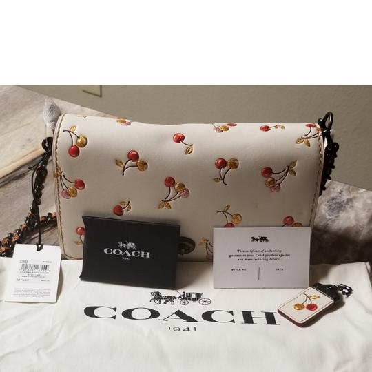 Preload https://item2.tradesy.com/images/coach-1941-dinky-with-cherry-print-glovetanned-leather-cross-body-bag-23917336-0-1.jpg?width=440&height=440