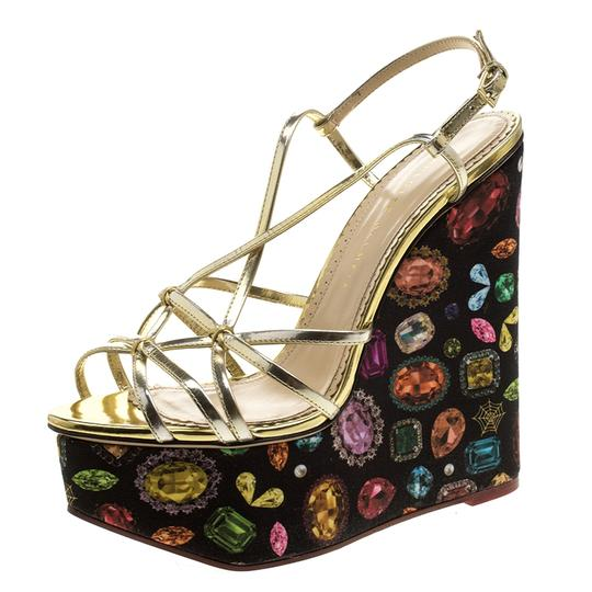 Preload https://img-static.tradesy.com/item/23917372/charlotte-olympia-metallic-gold-leather-elizabeth-jewel-print-wedge-sa-sandals-size-eu-40-approx-us-0-0-540-540.jpg