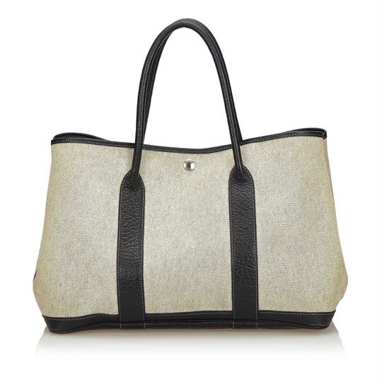 Preload https://item3.tradesy.com/images/hermes-garden-party-pm-white-canvas-x-others-x-leather-x-others-baguette-23917412-0-0.jpg?width=440&height=440