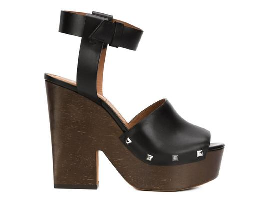Preload https://item3.tradesy.com/images/givenchy-sofia-clogs-sandals-in-black-calf-leather-pumps-size-us-10-regular-m-b-23917482-0-0.jpg?width=440&height=440