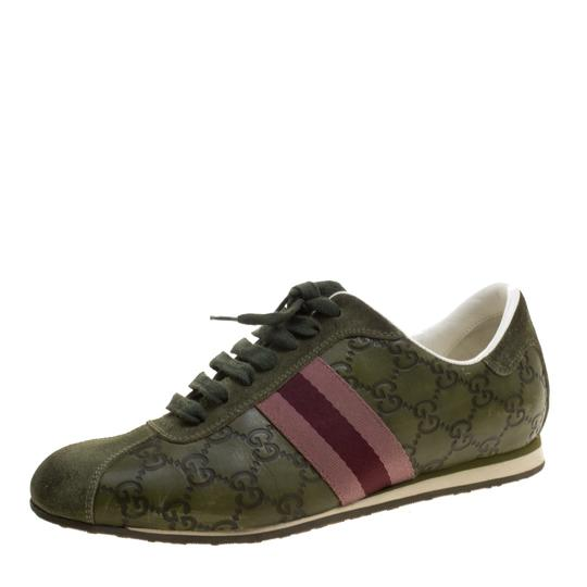 Preload https://img-static.tradesy.com/item/23917492/gucci-green-guccissima-leather-web-detail-low-top-sneakers-flats-size-eu-385-approx-us-85-regular-m-0-0-540-540.jpg