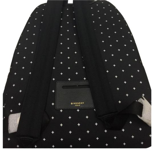 Preload https://img-static.tradesy.com/item/23917707/black-with-white-crosses-coated-canvas-backpack-0-1-540-540.jpg