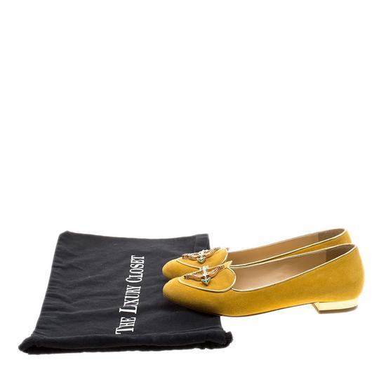 Preload https://item5.tradesy.com/images/charlotte-olympia-yellow-mustard-suede-sagittarius-smoking-slippers-flats-size-eu-36-approx-us-6-nar-23917739-0-0.jpg?width=440&height=440