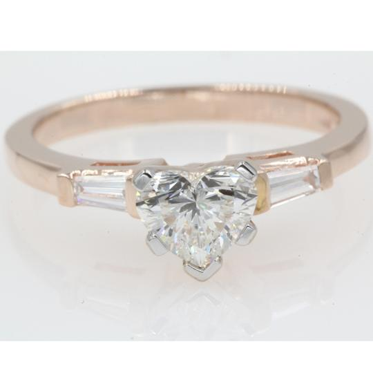 Preload https://img-static.tradesy.com/item/23926351/14k-rose-gold-86-carat-heart-shaped-tapered-baguette-engagement-ring-0-0-540-540.jpg