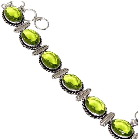 Preload https://img-static.tradesy.com/item/23926709/green-and-silver-new-peridot-85-bracelet-0-1-540-540.jpg
