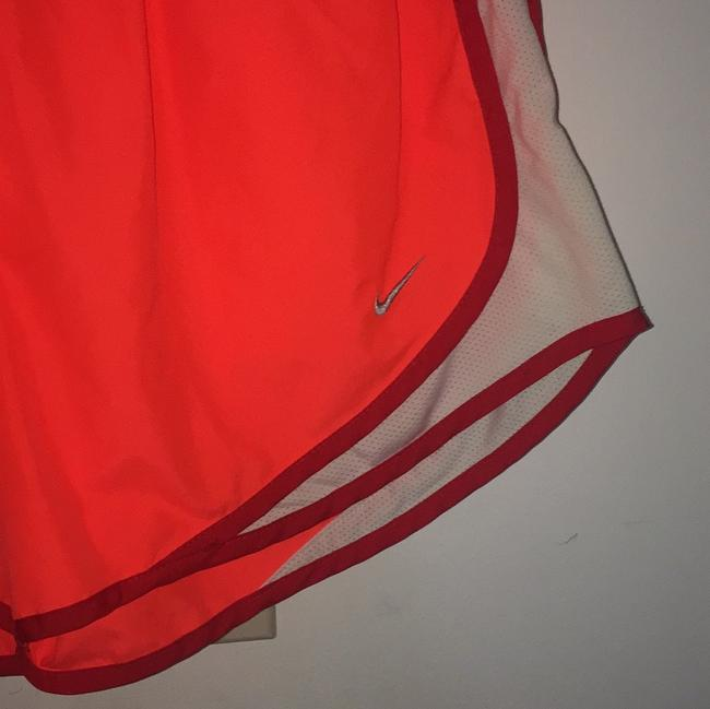 Nike neon orange running shorts