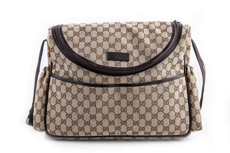 c2c54487f7d993 Gucci Gg Supreme Leather-trimmed Printed Brown Canvas Diaper Bag ...