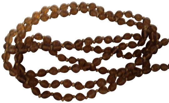 Preload https://img-static.tradesy.com/item/23937566/carol-dauplaise-brown-vintage-long-clear-stones-necklace-0-1-540-540.jpg
