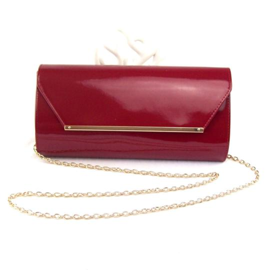 Preload https://img-static.tradesy.com/item/23939020/metro-style-ruby-red-patent-convertible-clutch-faux-leather-shoulder-bag-0-0-540-540.jpg