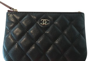 Chanel Chanel mini o case in black caviar leather and light gold hardware